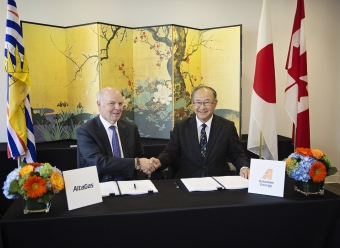 David Cornhill, Chairman and Founder, AltaGas and Osamu Masuda, President Astomos Energy celebrate the signing of an agreement for the sale and purchase of LPG from the Ridley Island Propane Export Terminal currently under construction