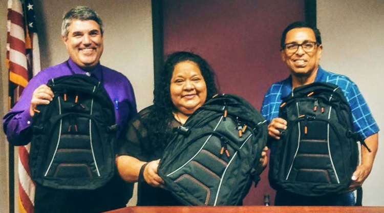 On Aug. 9, AltaGas' Administrative Assistant Olivia Lopez said she was very happy to play a part in the company giving back to the community and providing students with supplies that will start them off for what she hopes is a great school year. Pictured with Lopez is Superintendent Charles Bush (left) and board President Sonny Hernandez (right). (Photo by Cathyleen Rice/Palo Verde Unified School District)